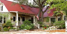 Authentic Custom Homes, LLC builds environments where life takes place. As the foremost Texas Hill Country design-build firm, Authentic Custom Homes has brought art to life for nearly 3 decades. Check them out! Love the red roof! Texas Country Homes, Texas Hill Country, Country Style Homes, Texas Homes, Custom Home Builders, Custom Homes, Fence Styles, Street House, House Roof