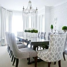 This grey is so modern and warm. I love the pattern on the chair and how bright the white curtains look.