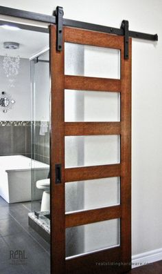 Love this door. It's so open! Where to buy sliding barn door hardware