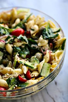 Vegetable lovers rejoice! This Veggie Lover's Greek Pasta Salad is absolutely bursting with baby spinach, cucumbers, tomatoes, bell peppers, Greek olives, and red onions all in a tantalizing garlicky herbed lemon dressing.