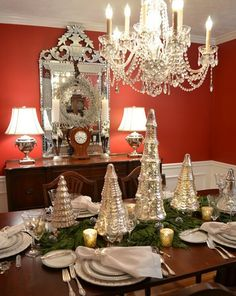 Mercury glass and silvery gray-green table cloth with pine and artificial snow….a magical table arrangement.