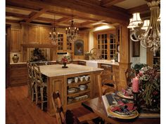 This rustic kitchen is so cozy and inviting! Geyer Victorian Home Kitchen Photo from houseplansandmore.com