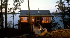 Novotny Cabin by Miller Hull. This cabin, located on Decatur Island in the San Juan Island chain, is perched on a steeply sloping site which terminates in an abrupt rock cliff at the waters edge. The cabin is shared by two couples who use it on an alternating schedule. The 840 s.f. structure is entered from a bridge onto the upper floor living/kitchen/dining area. Glass surrounds all four sides and deep six foot overhangs extend out to protect the outdoor decks.