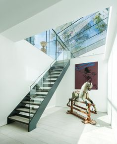 AR Design Studio have completed a glass extension on a house in Winchester, England