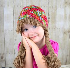 Adorable cabbage patch inspired hat for girls! Wonderful winter hat or Halloween Costume!  * Size - Comes in every size * Colorful • Handmade with 100% acrylic yarn • Pigtail beanie with bangs • Yarn doubled for extra warmth and durability • SUPER comfortable • Doubles as a costume piece or a winter beanie  Yumbabys cure for pre-premature baldness!!! This hat is absolutely smashing as well as warm and durable. The beanie is hand crocheted with bright high-quality yarn. The brown yarn hair is…