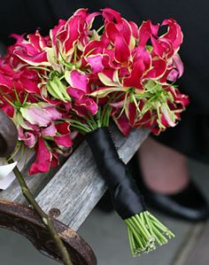 and I love this one....How can I pick one?     Fuschia Sweat Pea Bouquet with Black Ribbon