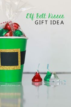 """Check out this cute Christmas gift idea, elf kisses treat idea, just fill a green cup with holiday Hershey kisses and tape on an """"elf belt"""" so fun! Cute Christmas neighbor gift idea or cute Christmas craft idea!"""