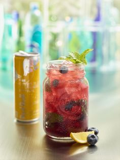 SUMMERTIME BLUES (alcohol free) Fresh blueberries, mint and Blueberry Reàl muddled together with made from scratch lemonade and the topped with Red Bull Tropical.