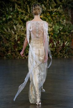 An embroidered lace-back wedding dress with ribbons by @clairepettibone | Brides.com