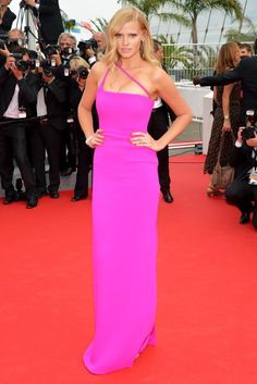 Lara Stone in a dramatic fuchsia Calvin Klein Collection gown