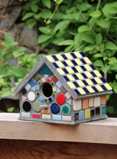 bird house...could use those left over tiles to do this.