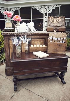 I like the staging of the guest book and cards with the antique furniture ... I have some pieces like those!