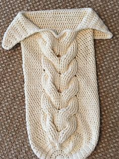 Trecce intrecci Skein and Hook: Free Crochet Pattern: Cabled Baby CocoonIf you're looking for an easy pattern that's almost too cute for words, then the Cuddly Crochet Cable Baby Cocoon is for you. This super snuggly cocoon features the cable stitch Crochet Baby Cocoon Pattern, Cute Crochet, Crochet For Kids, Beautiful Crochet, Knit Crochet, Baby Patterns, Knitting Patterns, Crochet Patterns, Crochet Baby Clothes