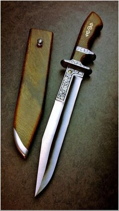 KnifeChambers. Made and engraved by Grant Chambers. Wenge wood.