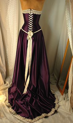 Handcrafted gowns from England - expensive, but elegant.  I wish I had occasion to own one! Purple Satin, Purple Dress, Purple Corset, Deep Purple, Vestido Medieval, Medieval Dress, Renaissance Gown, Medieval Fashion, Prom Dresses