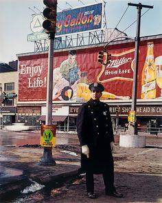 NYC. Policeman, 59th St.,1964 // Evelyn Hofer