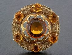 A Scottish citrine and gold brooch.