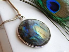 Check out this item in my Etsy shop https://www.etsy.com/uk/listing/559484333/genuine-labradorite-pendant-natural