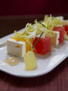 Our Compressed Watermelon Salad is the quintessential summer treat. Enjoy juicy cubes of compressed Red and Yellow Watermelon infused with Mint, paired with Feta Cheese, Ginger and Frisee. This salad is so sweet, you'd swear it was dessert.
