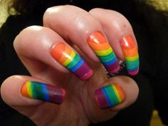 Rainbow Water Marble Nail Art: Inspired by the colours of the rainbow, bits of various colored nail polishes are painted horizontally in gentle strokes. This multi-coloured nail art design is sure to be a hit with women who are not afraid to take a risk.