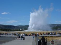 Visit Yellowstone National Park and Old Faithful.