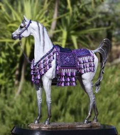 Bronze Arabian by Anne Butler;  heh, what horse crazy little girls collect when they grow up :)