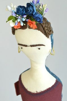 Vinny dolls are whimsical dolls handmade in Dubai, UAE and shipped worldwide. Buy online Frida doll made after Mexican artist Frida Kahlo with Apron costume.
