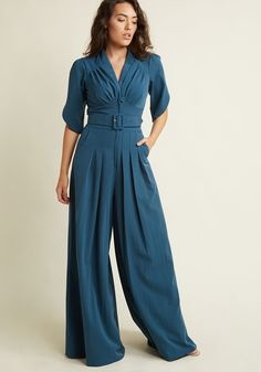 In this golden era of inspiration, you feel encouraged to sport this dark teal jumpsuit by Miss Candyfloss. Inspirited by its gathered bust, tulip-style...