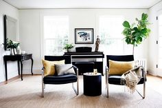 "The family room was renovated so that it opened up to the kitchen. ""The black-and-white theme is repeated with the cowhide rug and modern furnishings, too,"" said Staton."