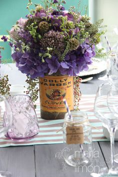 Flower in a vintage can #vintage #purple #wedding #flowers #tablenumber #hydrangeas #roses #can #centerpiece