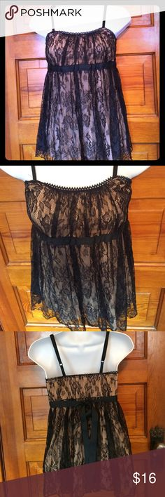 🚨SALE! Black Lace Babygirl Top Black Lace overlaying a nude slip.  Ties in back. Beautiful floral design.  Excellent Condition! ❤️Save 30% on this by bundling another item with it!! S-Twelve Tops Tank Tops