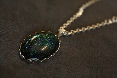 Spoiled Use Protection Nail Polish Necklace (over black) - blue teal silver iridescent multi colored glitter. $10.00, via Etsy.