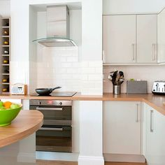 Wood-effect kitchen worktops and flooring | Take a tour of this light and modern kitchen | housetohome.co.uk | Mobile