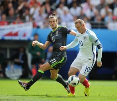 Bale keeps a close eye on Wayne Rooney as the England captain enjoys a period of possession