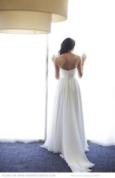 this dress is so perfect!!! lowish back, flowy a-line skirt, buttons down the back, natural and feminine waistline. sweetheart neckline would make it