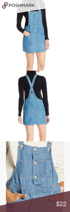 Levi's Denim Overall Dress  Bring back a classic vintage look with this denim dress with an overall silhouette. Relaxed fit 100% Cotton Lightweight Denim Pockets front and back. Levi's Jeans Overalls