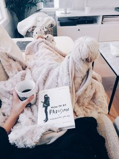 how to be parisian. faux fur blanket. couch time. coffee. slippers. furry friend. bright quiet calm. living room. me time.