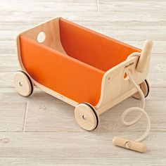 Shop Orange Wooden Wagon. Your child will enjoy collecting things and moving them around the house with our orange wagon! They can even create a wagon train with multiple wagons laced together with the removable rope.