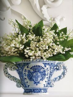 Make a simple yet stylish Spring arrangement by placing delicate lily of the valley in a blue china container. Perfect for a dresser or Easter table setting. By Carolyne Roehm from her book 'Flowers' http://carolyneroehm.com/books/