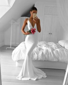 Classy slim white dress. If I have a very small intimate wedding I would like a dress of this style - @Beejoloves