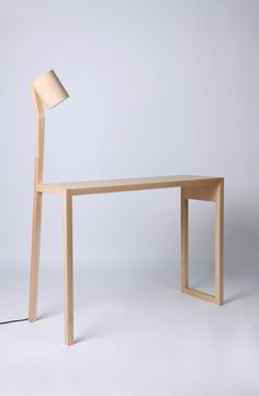 earl-pinto kink desk with reading light - writing desk in solid american maple, with in-built reading light.  Designed in collaboration with gerard pinto- see earlpinto.com.au for more objects…