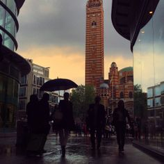 Sunlight gleams through stormy skies over Westminster Cathedral in London 17°C I 62°F #BurberryWeather