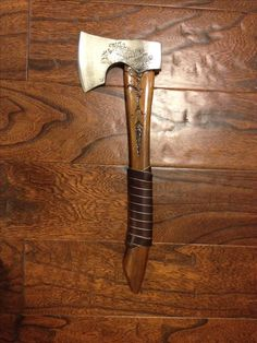 Bearded axe custom camp axe ( tree growing onto blade, roots morphing into spear head )