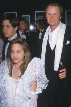 A young Angelina Jolie steps out at the Academy Awards with dad Jon Voight, 1986.