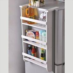 O si tu refrigerador no está adosado a una pared, convierte el lado libre en un…