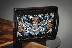 Decorative serving tray with intricate rosemaling design hand painted by artist Sue Schlingman.