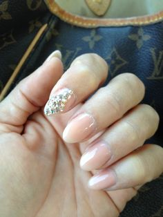 Almond shaped nails-- a more tame version of the stiletto
