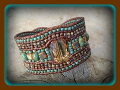 The crystal focal point adds for a nice mixture with the turquoise gemstones, czechmate tiles and Picasso seed beads in this 5 row wrapped leather