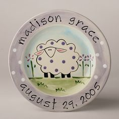 """9"""" Sheep Plate shown in Lavender. Also available in Pink and Yellow. - Handmade item - Personal message up to 8 words may be painted on back - Material: ceramic plate non-toxic paints and glazes - Mad"""
