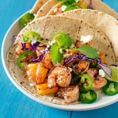 Grilled Shrimp and Pineapple Tacos Recipe Main Dishes with flour tortillas, shrimp, unsalted butter, lime, garlic, ground cumin, kosher salt, freshly ground black pepper, pineapple rings, jalapeno chilies, red cabbage, cotija, fresh cilantro